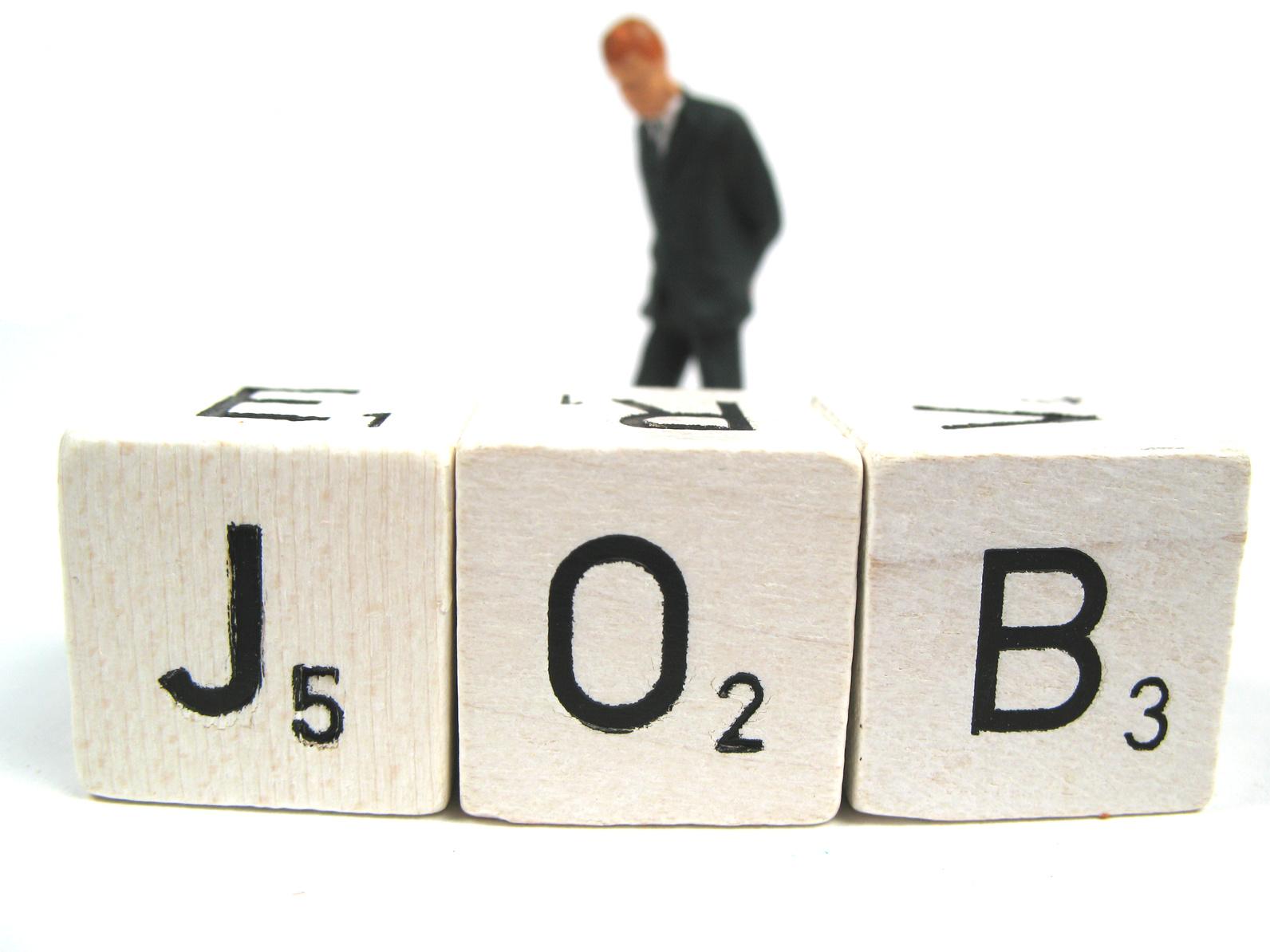 Jobs Mann mit Würfel